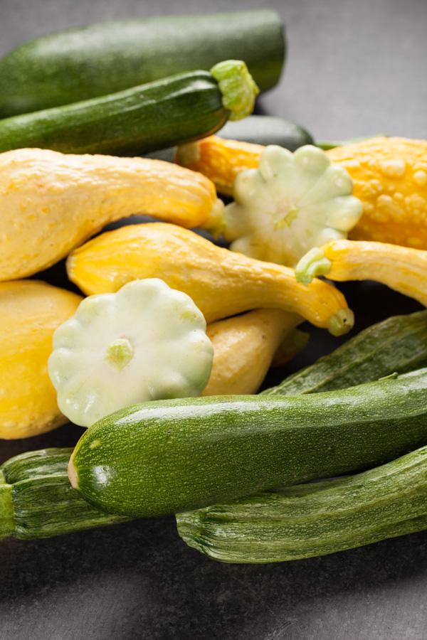 Pile of assorted zucchini and summer squash for Zucchini Hamburger Bean Chili