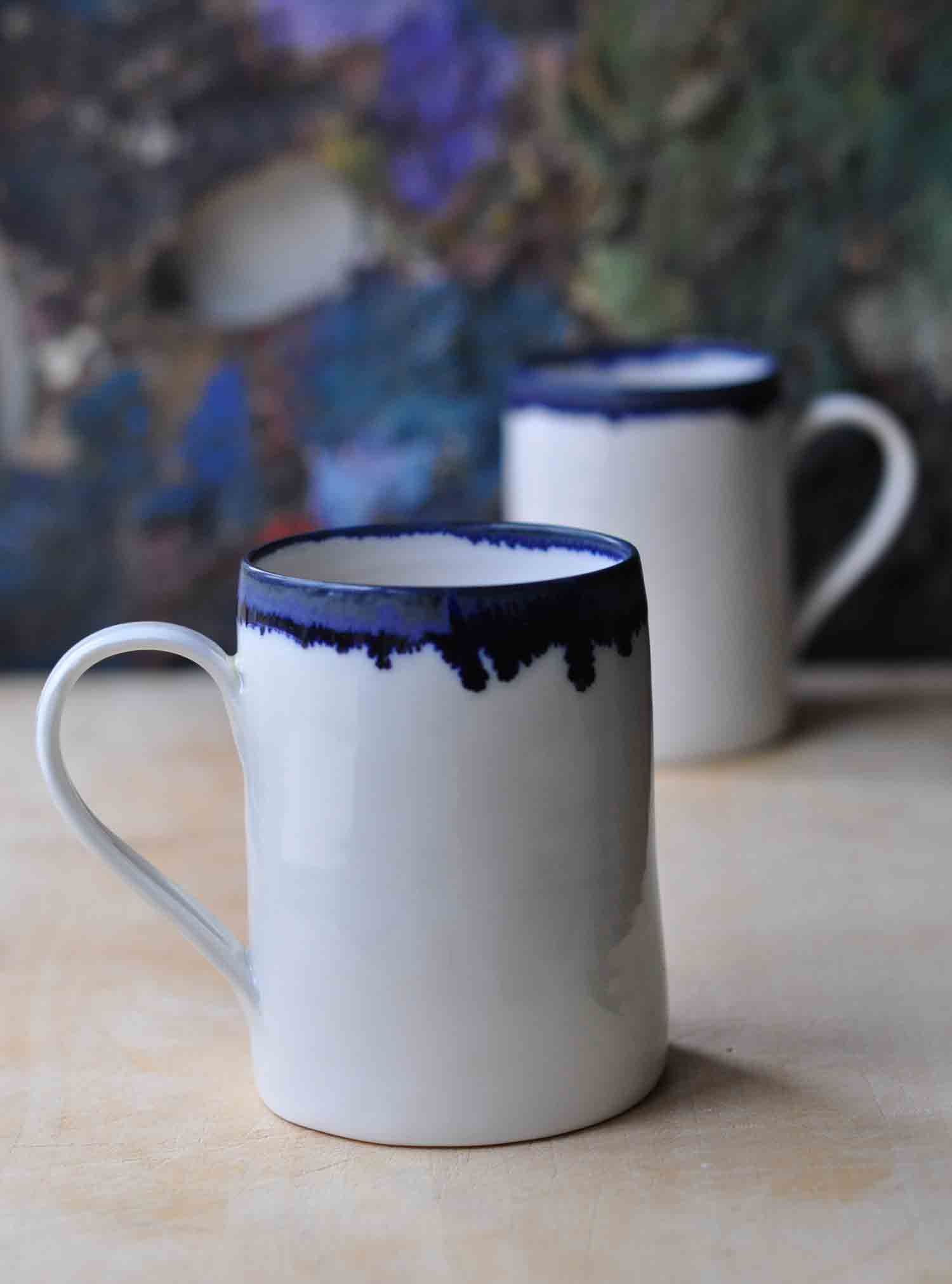 Hand Thrown Porcelain Mug With Indigo Rim By Edit Juhasz