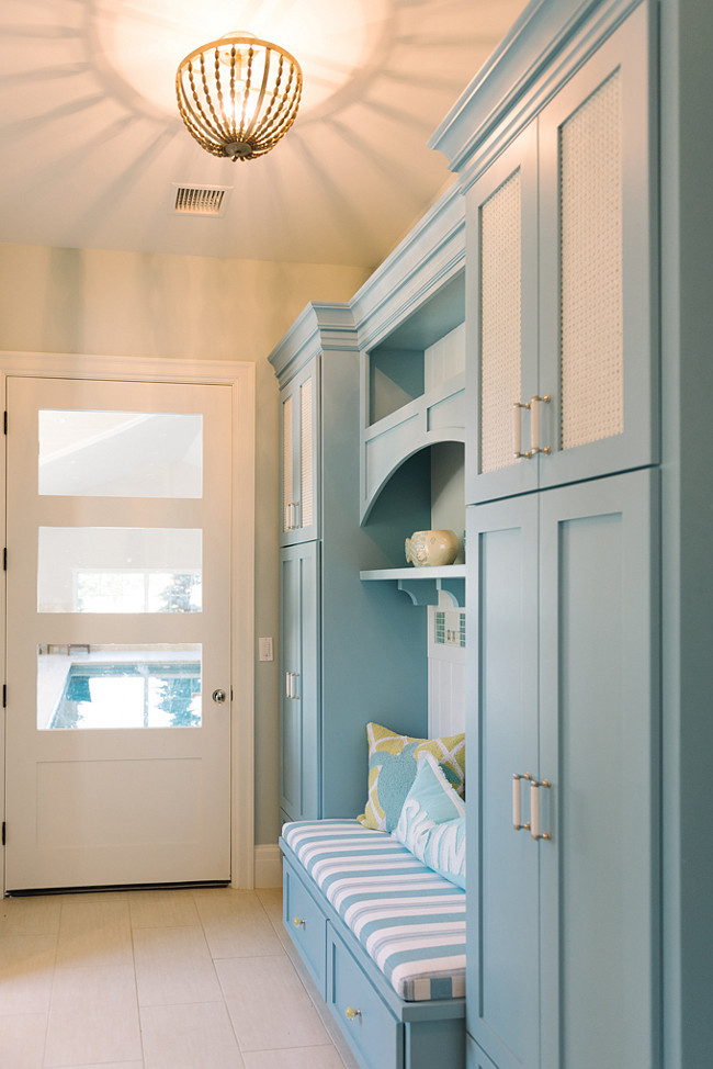 Mudroom Cabinet and wall paint color combination. The mudroom cabinet paint color is Benjamin Moore Marlboro Blue HC-153 and Benjamin Moore White Dove OC-17. The mudroom wall paint color is Benjamin Moore Cool Breeze CSP-665.