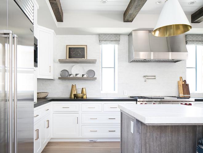 Kitchen Floating Shelves. Reclaimed wood kitchen shelves. The kitchen floating shelves are rift white oak. #KitchenFloatingShelves #kitchen #FloatingShelves #kitchenshelves #Reclaimedwoodshelves Patterson Custom Homes