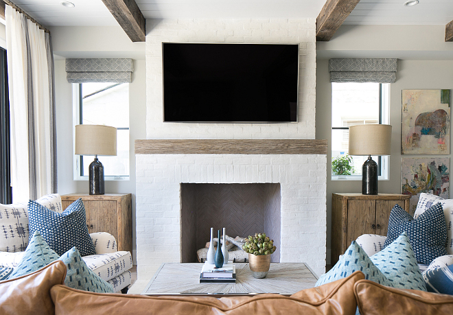 Brick Fireplace. White brick fireplace with reclaimed wood mantel. Painted White brick fireplace with reclaimed wood mantel. #Whitebrickfireplace #reclaimedwoodmantel Patterson Custom Homes