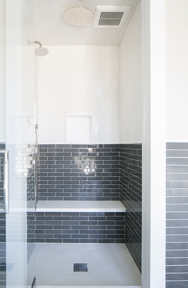 "Shower Tiles. Bathroom shower tiling. Shower tiling. The shower features upper walls clad in white mosaic tiles and lower walls clad in charcoal gray brick tiles lined with a white floating shower bench hovering over a white mosaic tiled shower floor. Master Bath- Shower walls: 2""x10"" Piastrella Grigio with ¾""x12"" Thasos. Chelsea molding. #showertiles #showertiling #shower #tile Patterson Custom Homes"