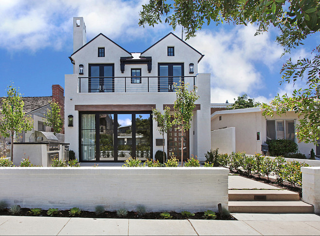 "Exterior Ideas: Exterior paint color is Dunn Edwards Whisper White. The exterior is white smooth trowel plaster and white brick. Lanterns are "" E.F. Chapman 2 Light Outdoor Wall Lantern in Bronze (CHO2910BZ)"". Roof is Black Aluminum Standing Seam Roof— Maintenance free: will not rust, crack, or rot… Resists streaking and staining… Never needs cleaning. Gutters are black aluminum to match standing seam roof. #Exteriors #Homeexterior #exteriorideas #Brickexterior #Exteriorpaintcolor #DunnEdwardsWhisperWhite Patterson Custom Homes"