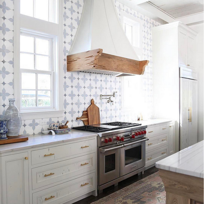 Benjamin Moore White Dove. White Kitchen with Pecky Cypress Cabinets painted in Benjamin Moore OC-17 White Dove. The vintage kitchen runner is from Etsy. Countertops are Macaubus Quartzite. Benjamin Moore White Dove. White Kitchen with Cypress Cabinets painted in Benjamin Moore White Dove. Benjamin Moore White Dove. White Kitchen with Pecky Cypress Cabinets painted in Benjamin Moore White Dove #BenjaminMooreWhiteDove #WhiteKitchen #kitchen #PeckyCypressCabinets #PeckyCypress #BenjaminMooreWhiteDove #BenjaminMooreOC17WhiteDove Old Seagrove Homes