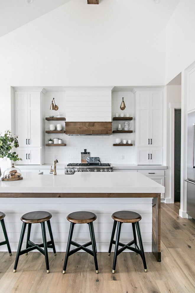 Crisp White Farmhouse Kitchen. Crisp White Farmhouse Kitchen with shiplap hood and brick backsplash. Crisp White Farmhouse Kitchen #CrispWhiteFarmhouseKitchen #WhiteFarmhouseKitchen #FarmhouseKitchen #shiplaphood #brickbacksplash Sita Montgomery Interiors