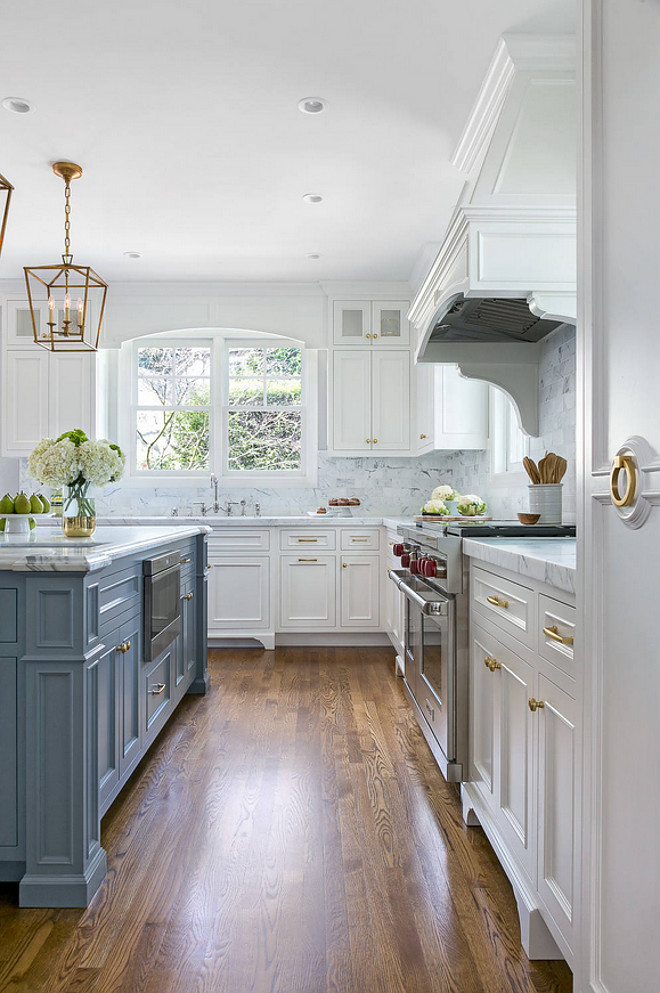 White Kitchen With Stacked Cabinets And Grey Island Home