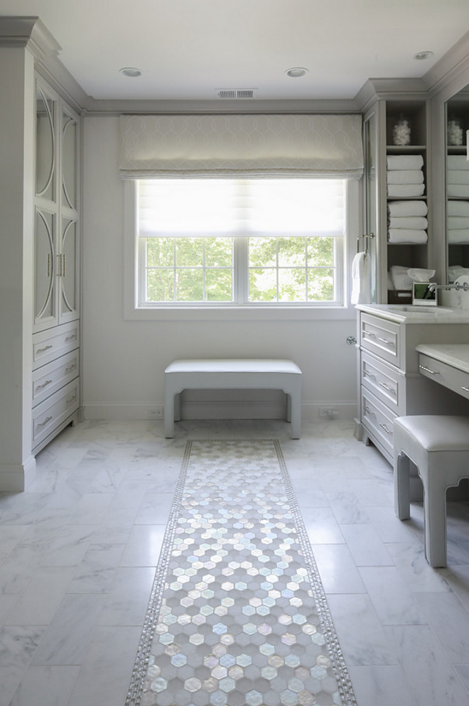 Bathroom Marble Tile Runner. Bathroom features marble floor tile with hex white marble tile runner and glass tile boarder #bathroomtile #marbletile #bathroomtilerunner #tilerunner #tileboarder Hartley and Hill Design