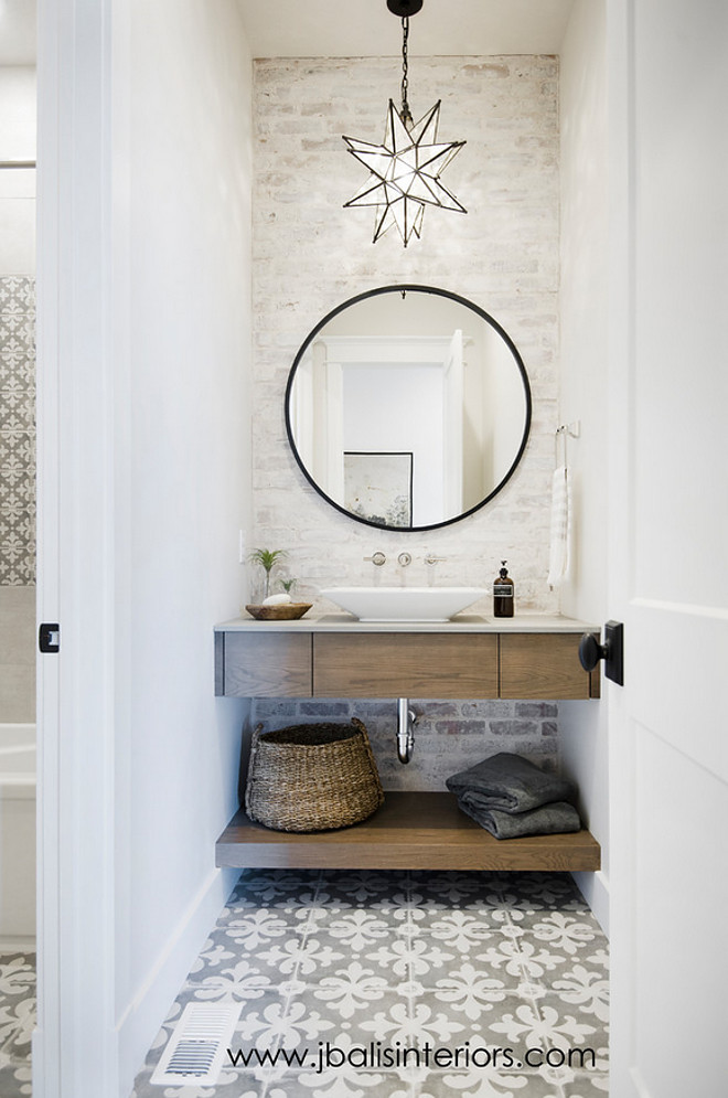 Farmhouse Bathroom with freestanding vanity, cement tile and painted brick wall. Farmhouse bathroom #farmhousebathroom #farmhouse #bathroom Judith Balis Interiors