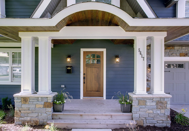 Wooded front door is by Simpsons Doors. Porch: cedar wood decking (for the deck). Hem fir for the ceiling (with a dark stain). Cedar and Miratek for the columns.  Sicora Design/Build