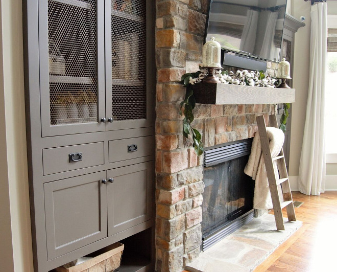 Living room cabinets flank stone fireplace. Living room cabinets paint color is Sherwin Williams Urbane Bronze SW 7048. Living room cabinets flank stone fireplace. Living room cabinets paint color is Sherwin Williams Urbane Bronze SW 7048. Living room cabinets flank stone fireplace. Living room cabinets paint color is Sherwin Williams Urbane Bronze SW 7048. Living room cabinets flank stone fireplace. Living room cabinets paint color is Sherwin Williams Urbane Bronze SW 7048. Living room cabinets flank stone fireplace. Living room cabinets paint color is Sherwin Williams Urbane Bronze SW 7048. Living room cabinets flank stone fireplace. Living room cabinets paint color is Sherwin Williams Urbane Bronze SW 7048 #Livingroomcabinets #cabinets #paintcolor #SherwinWilliamsUrbaneBronzeSW7048 Home Bunch Beautiful Homes of Instagram @mygeorgiahouse