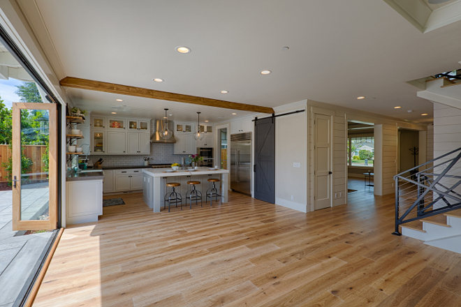 Open kitchen layout with hardwood floors on the entire main floor. AK Construction
