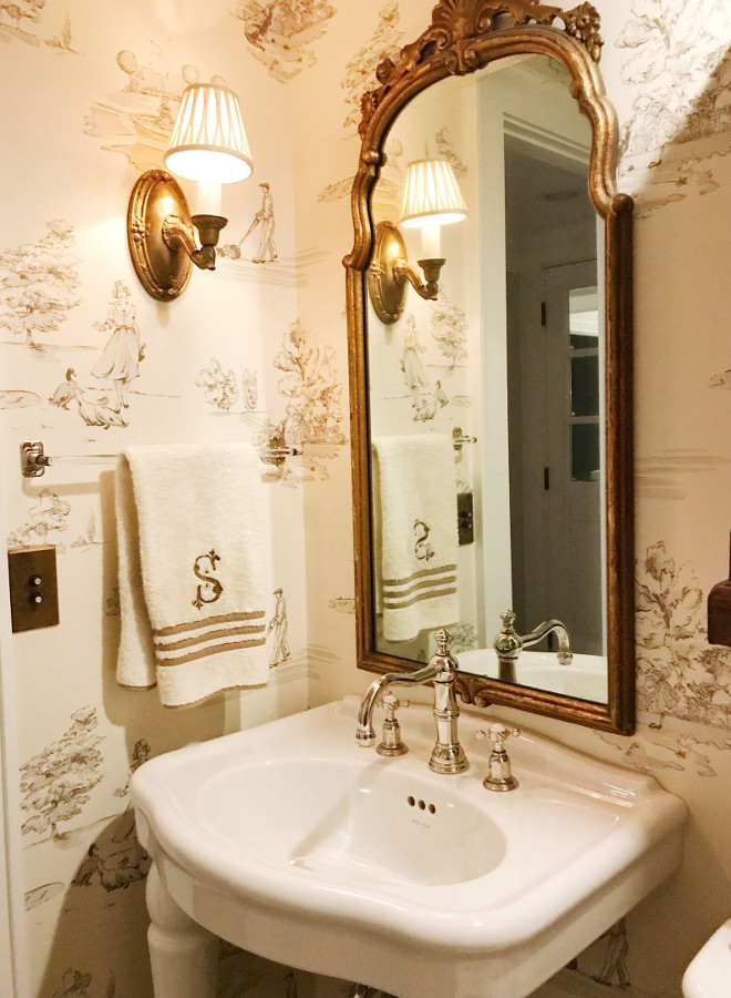 "Powder room wallpaper and gilded mirror. Powder Room with antique mirror and sconce with the my favorite, Nina Campbell ""promenade"" wall covering. Sink and faucet by Kohler. Towel bar is antique. #powderroom #wallpaper #gildedmirror Beautiful Homes of Instagram @SweetShadyLane"