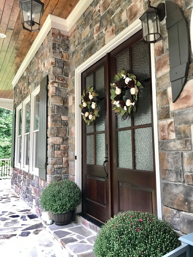 Stone exterior porch with double wood and glass front door. The stone is manufactured from Premier Stone Products in the ruble style in the color Sierra. Stone exterior porch with double wood and glass front door. Stone exterior porch with double wood and glass front door. Stone exterior porch with double wood and glass front door #Stoneexterior #stone #exterior #porch #doublefrontdoor #woodandglassfrontdoor Home Bunch Beautiful Homes of Instagram @mygeorgiahouse