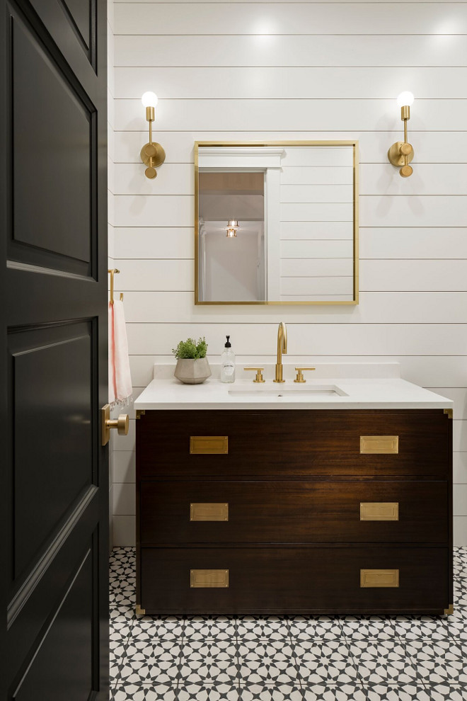 Modern Farmhouse Powder Room with shiplap paneling and cement floor tile. This powder room features a stunning custom vanity with white quartz countertop, shiplap walls and cement tile. The cement tile is Estrella Black Pattern #ModernFarmhouse #PowderRoom #shiplap #paneling #cementfloortile A Finer Touch Construction