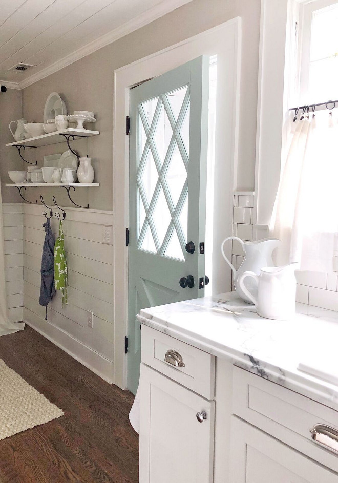 Sherwin Williams Agreeable Gray Farmhouse kitchen with shiplap paneling and neutral wall paint color Sherwin Williams Agreeable Gray #SherwinWilliamsAgreeableGray