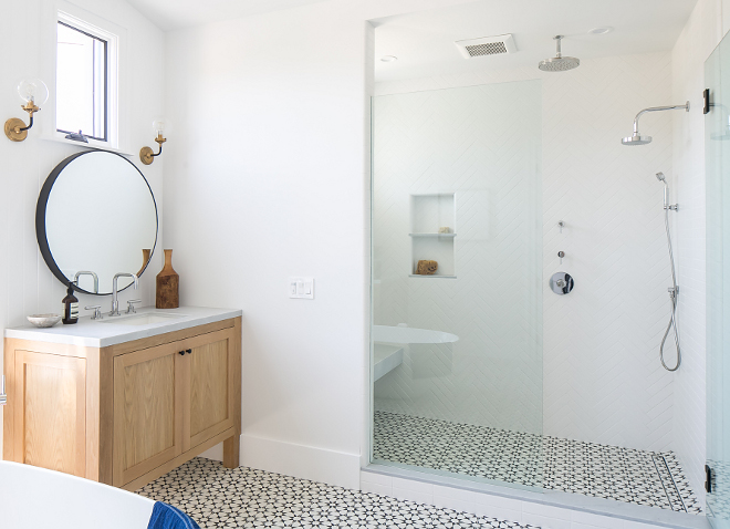 Shower Tile Shower floor tile is cement tile and walls are herringbone white tile The shower wall tile is a white tile set in a herringbone pattern Matte white 3x6 and 2.5 x 9 in straight joint, herringbone, and chevron patterns by Sonoma Tile