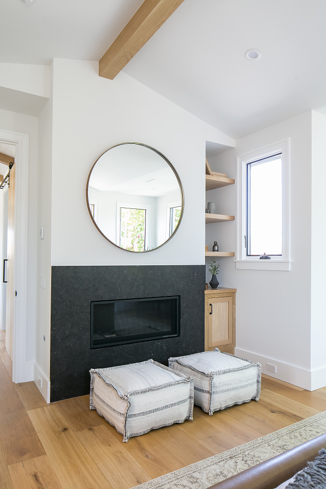The bedroom fireplace is honed Belgian Limestone
