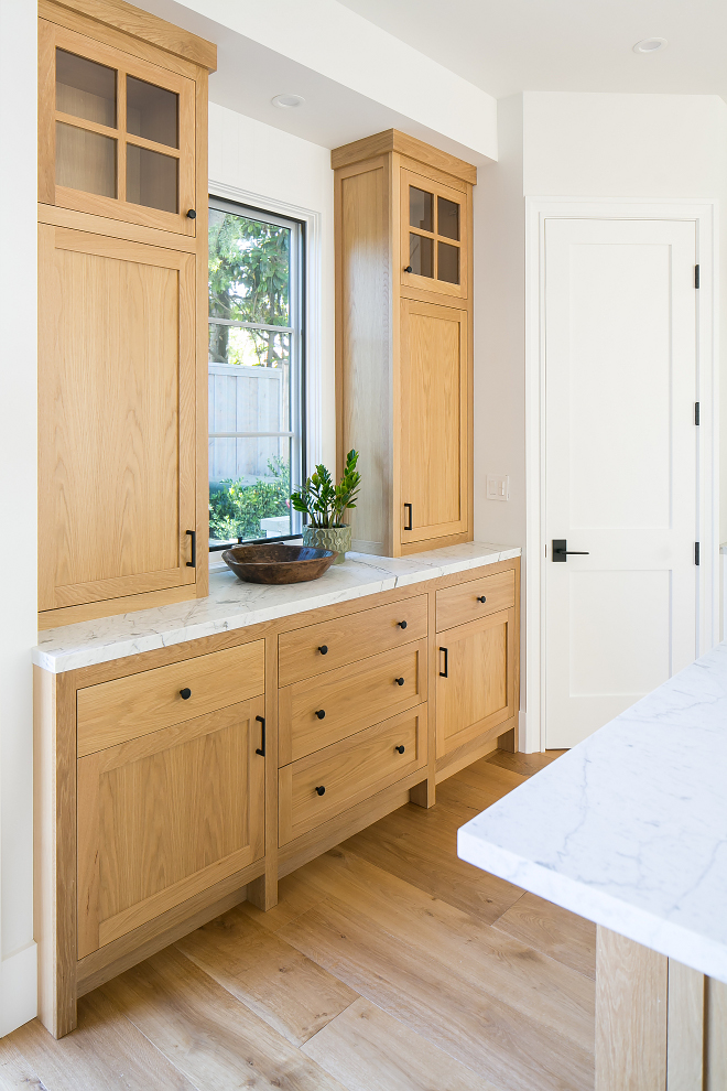 White Oak Kitchen Buffet Cabinet with white marble countertop and black hardware