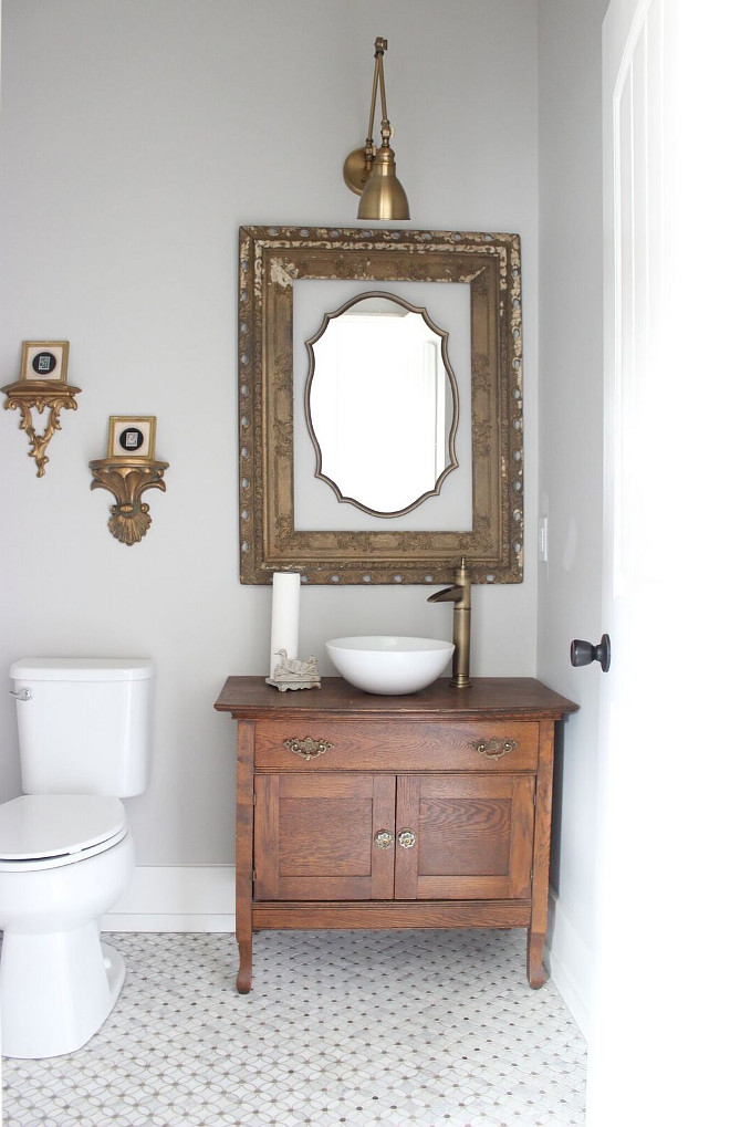 The half bath is also near and dear to my heart. My grandmother's washstand was repurposed to become the sink vanity and other vintage pieces hang simply throughout. I went with brushed gold in here to tie in the flower floral marble mosaic flooring which was a splurge, but my absolute favorite tile Beautiful Homes of Instagram Home Bunch @crateandcottage