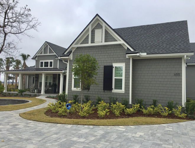 Siding is Chelsea Gray by Benjamin Moore and trim is White Dove by Benjamin Moore