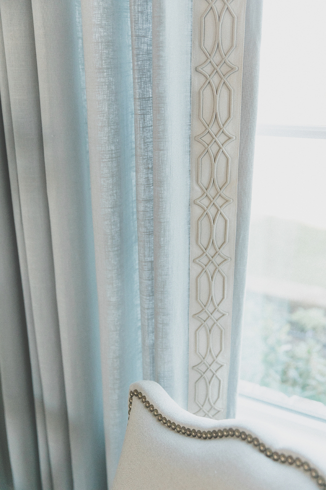 Foyer drapes are a French Blue with a custom embroidered banding on a French rod