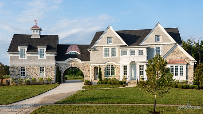 Stone and shingle home exterior Stone and shingle home exterior with copper accents Stone and shingle home exterior