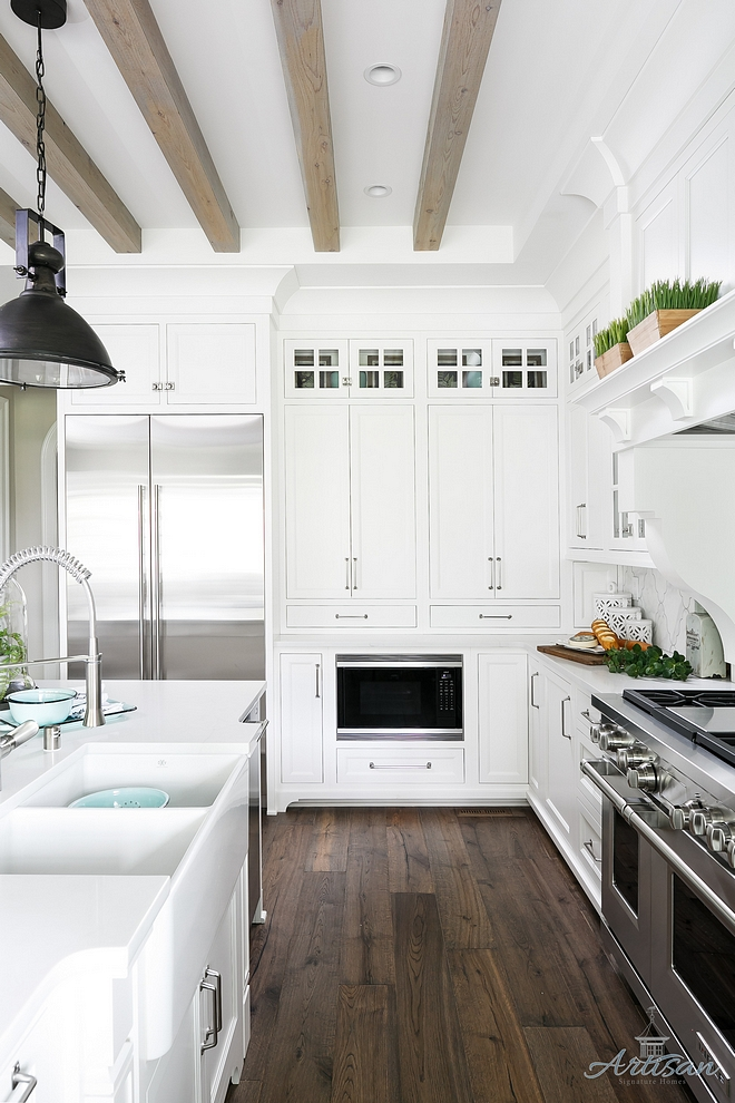 White Kitchen Dark Hardwood flooring and bleached ceiling beams