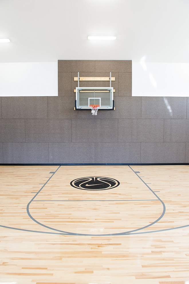 Basket court wall protection The walls are carpeted to not only protect from damage but to also help with sound