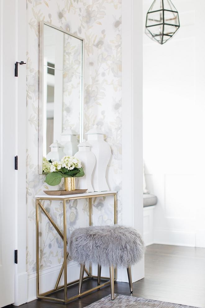 Foyer Decor Neutral Foyer Decor Ideas Brass console table and Grey Mongolian Lamb Stool Foyer Decor