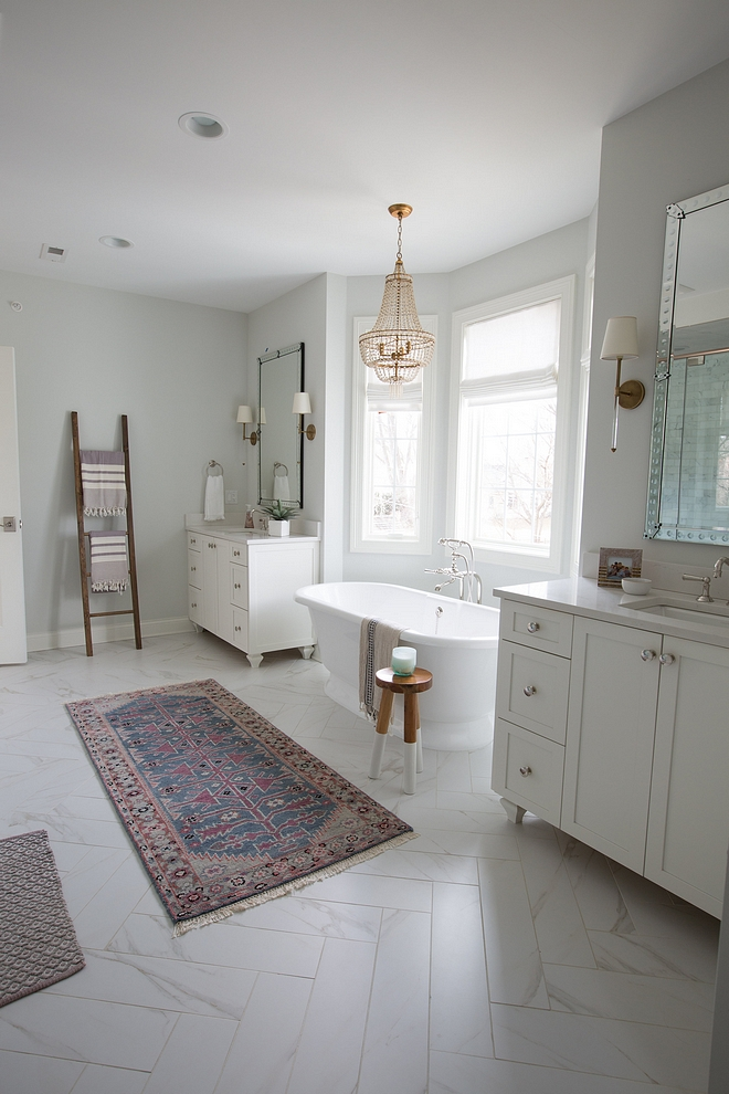 Herringbone bathroom tile Herringbone bathroom floor tile The tile floor is actually a porcelain that looks like marble, but of course without the maintenance or cost We cut them in half and laid them in a pretty herringbone pattern