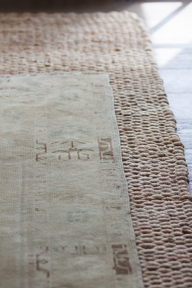 Layred Rug Trend Jute rug with antique rug on top layered rug trend Oushak rug