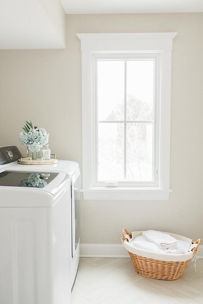 Benjamin Moore Sea Salt for this laundry room with wood looking floor tile in herringbone pattern Benjamin Moore Sea Salt Benjamin Moore Sea Salt #BenjaminMooreSeaSalt