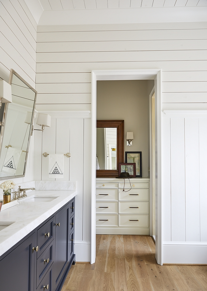 Shiplap Walls paint color Benjamin Moore PM- 20 China White with cabinets painted in Benjamin Moore Midnight Oil Bathroom features a combination of vertical and horizontal shiplap paneling #BenjaminMoore #paintcolors