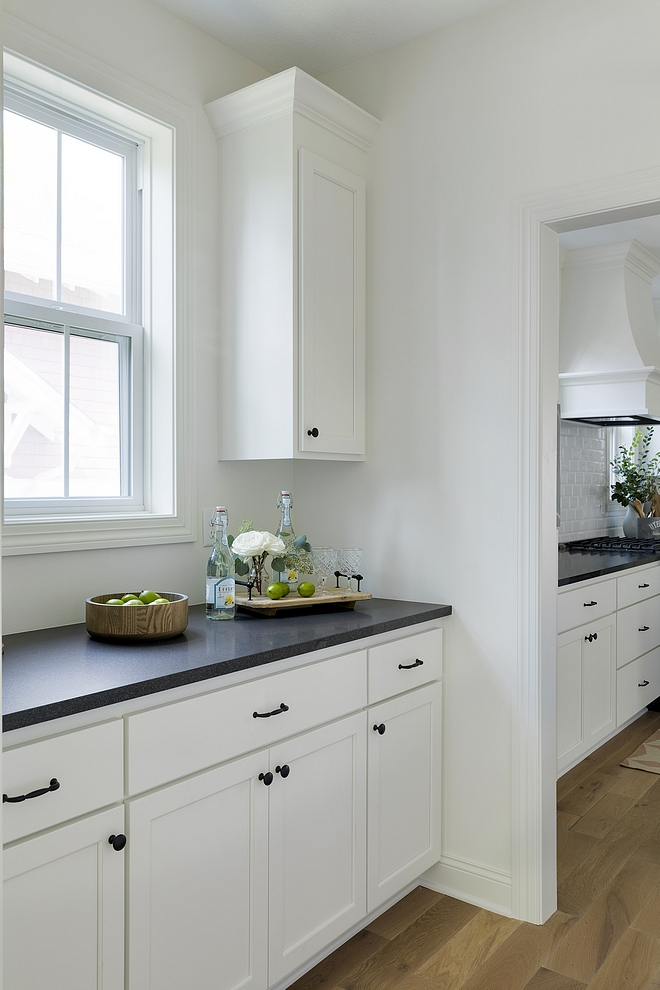 Benjamin Moore OC-17 White Dove Kitchen Cabinet with honed black granite and black hardware
