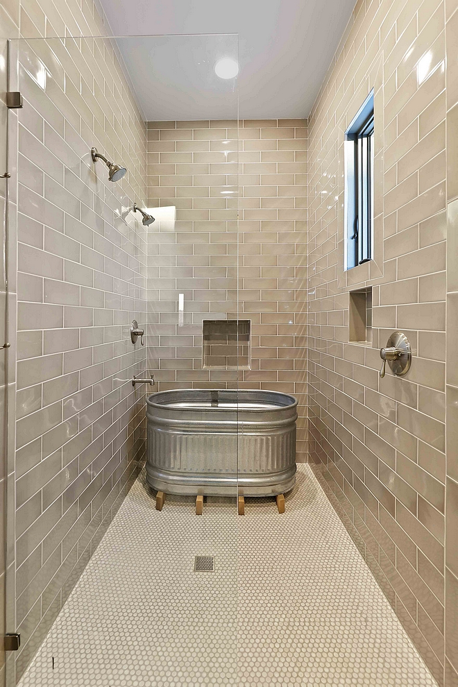 Farmhouse Bathroom Shower This farmhouse shower features a galvanized steel round end stock tank as a small bathtub #farmhouse #bathroom