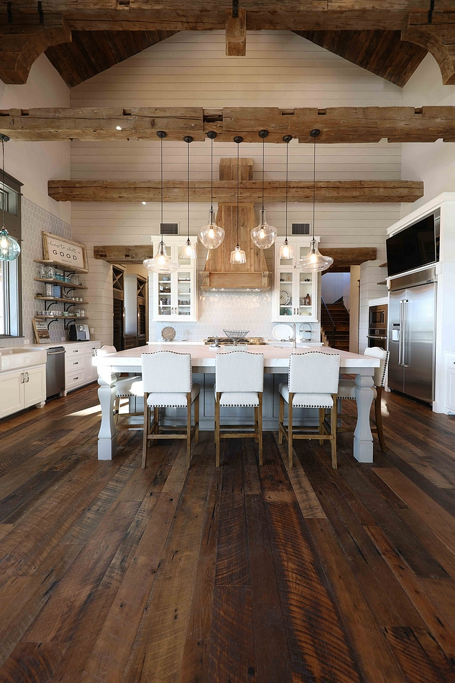 Rustic Kitchen Rustic Kitchen Gorgeous textures were added to this rustic kitchen with reclaimed wood floors, shiplap walls, reclaimed beams and reclaimed barn wood #rustickitchen #reclaimedwoosfloors #shiplap #reclaimedbeams #barnwood