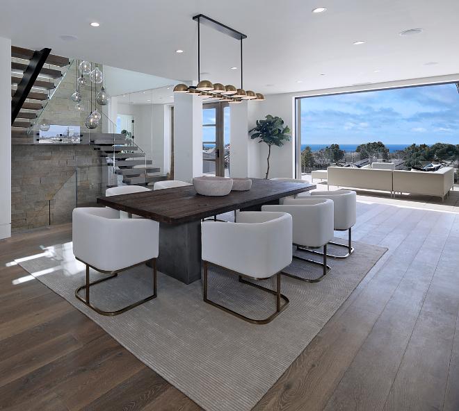 Modern dining room This sleek dining room features an open and airy feel. Chandelier is custom #moderndiningroom #diningroom