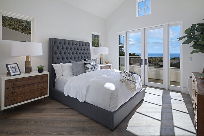 Inviting bedroom with grey tufted bed and mid-century inspired dressers