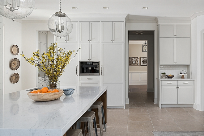 Classic Gray by Benjamin Moore Kitchen the cabinets are NOT white They are painted Benjamin Moore Classic Gray - this is my go-to color for creating the illusion of light and bright but with more warmth and depth The walls are Benjamin Moore White Dove