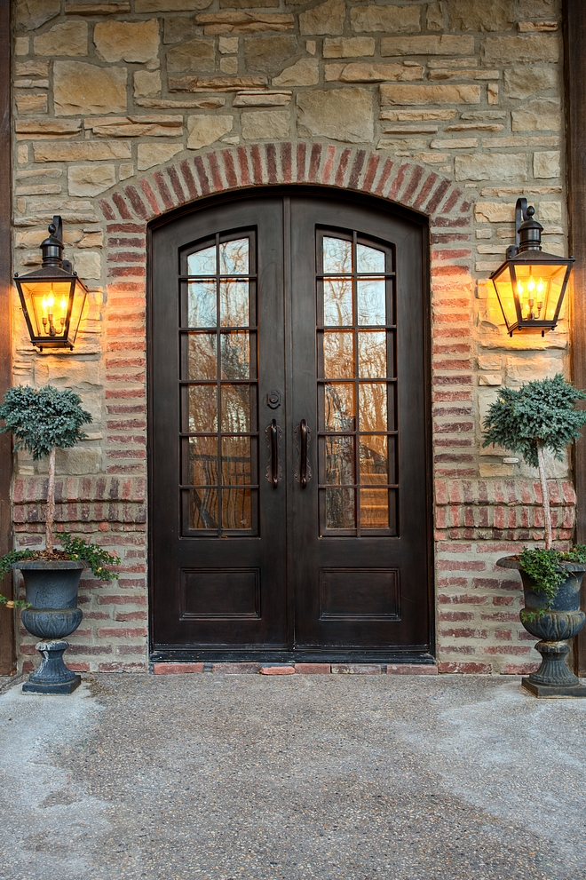 Iron and glass front doors with stone and brick accent Front doors custom in iron The doors are 8' tall and 5' wide #Irondoor #frontdoors