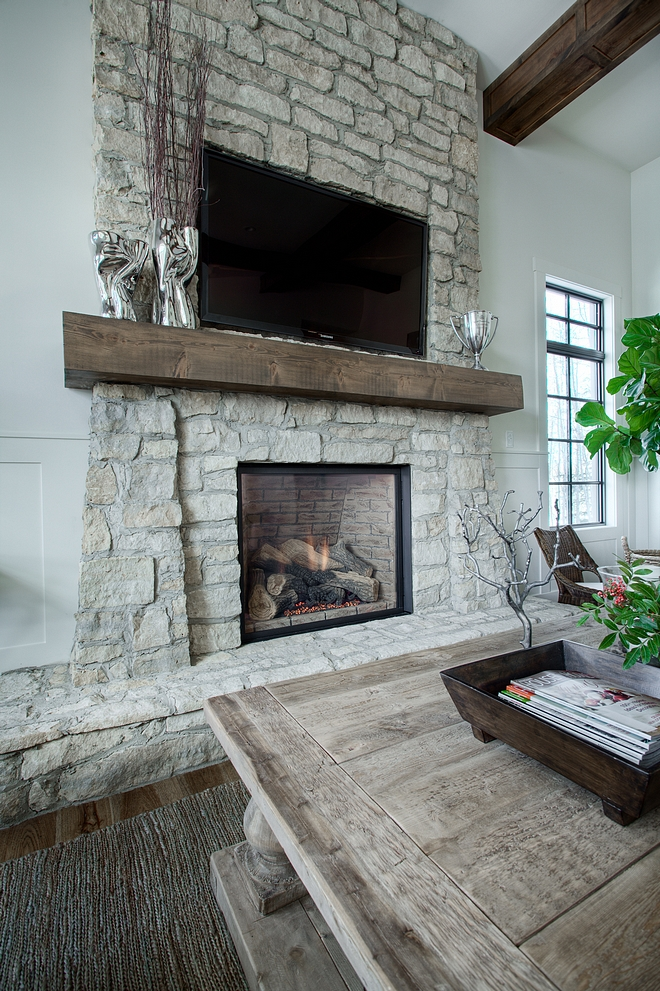 Rustic Stone Fireplace The stone on the fireplace is a natural stone veneer It's similar to Montana Quartz Farmhouse Rustic Stone Fireplace #RusticStoneFireplace #RusticFireplace #StoneFireplace