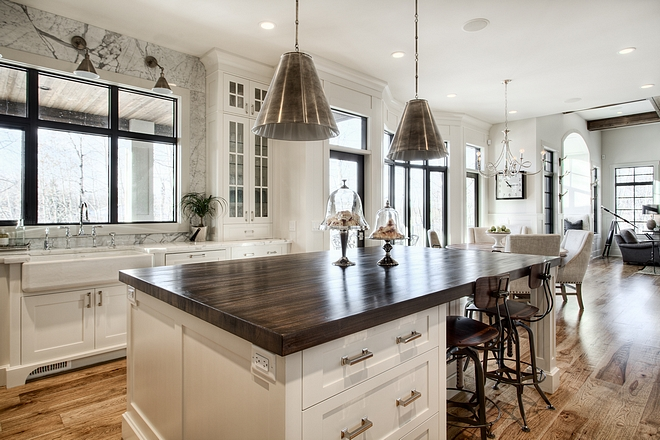 Kitchen island with Antique Nickel pendants industrial counterstools and butcher block countertop all sources on Home Bunch #kitchenisland #sources