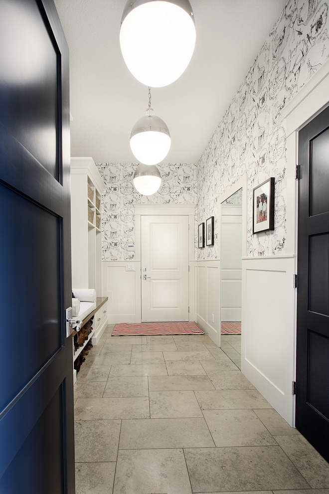Mudroom Mudroom Ideas Mudroom features limestone floor laid in hop scotch pattern oversized globe pendants wainscoting and wallpaper above wainscoting #mudrrom