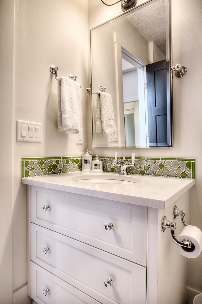 Kids bathroom with pivot mirro small vanity with drawers white quartz countertop and Glass bubble tile