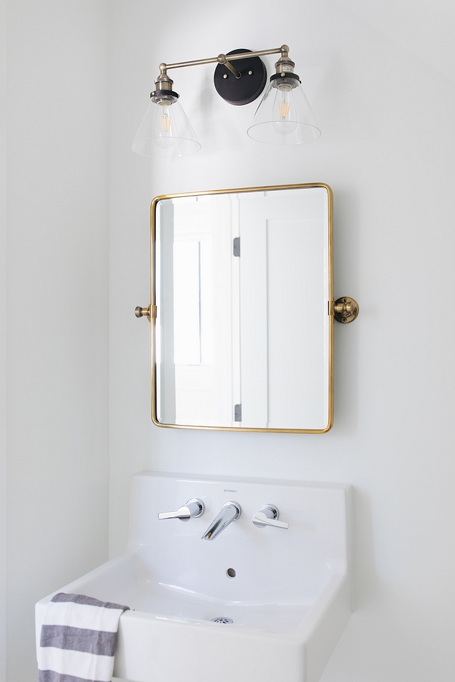 Brass Bathroom Mirror with sconce above Brass Mirror Bathroom Brass mirror #brassbathroommirror #bathroom #brassmirror #bathroomirror #bathroombrassmirror