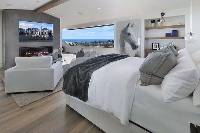 Master Bedroom concrete fireplace and sliding doors Beautiful Master Bedroom with concrete fireplace and sliding doors #masterbedroom