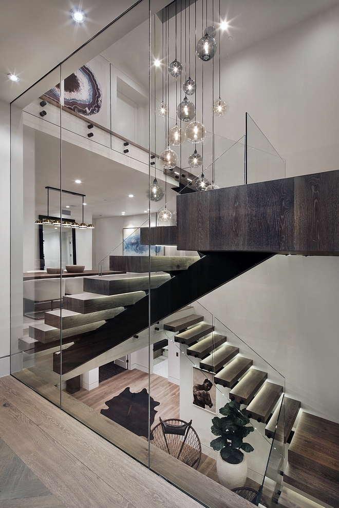 Modern Stair Railing Glass rails on standoffs with stainless rail Modern Glass Stair Railing Glass rails on standoffs with stainless rail #ModernStair #Railing #Glassrails