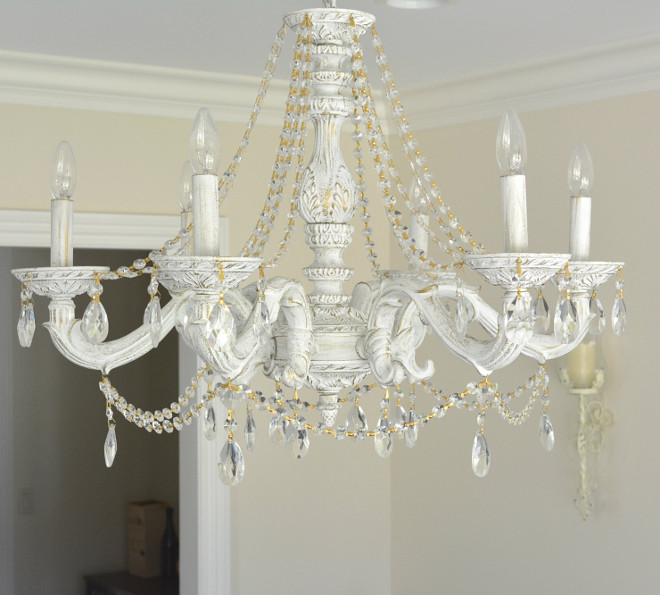Traditional Chandelier Painted Here's a close up of our chandelier from Wayfair I just love the distressed look and how the gold accents of the crystal chain pop against the white of the wood