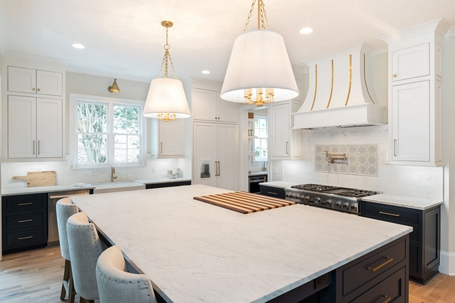 Honed white marble kitchen island with built in butcher block The Carrera Marble tops were hand picked from a local slab yard after countless hours searching for the perfect ones #carreramarble #countertop #slab