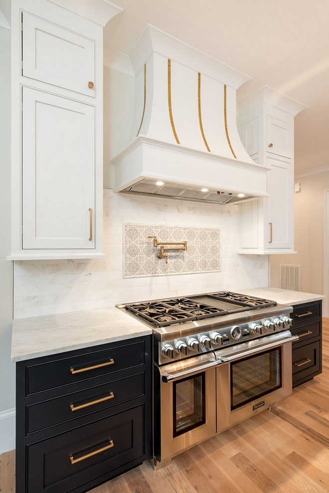 The colors on the cabinets are custom but they're similar to Benjamin Moore Soot (lower cabinets) and Benjamin Moore Decorator's White (upper cabinets)